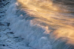 Wave breaking with spray Stock Photo