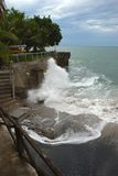 Wave breaking on the walkway of the cliff Royalty Free Stock Image