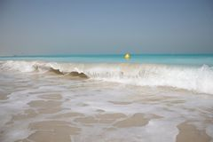 Wave breaking on white sand Royalty Free Stock Images