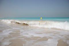 Wave breaking on idyllic white sandy beach Royalty Free Stock Images