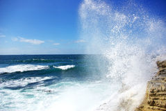 A wave breaks in the rock. Stock Photos