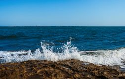 The wave breaks on the rock. The waves breaks on the rock stock photography
