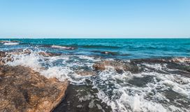 The wave breaks on the rock. The waves breaks on the rock royalty free stock images