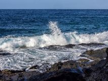 Wave breaks on the rock, Pantelleria, Italy stock photo