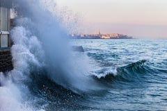 A wave breaks in Saint-Malo. A wave breaks in Rochebonne, Saint-Malo, France in February 2019 royalty free stock photo