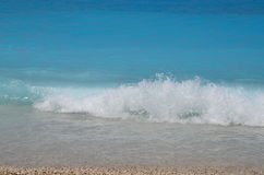 Wave. Byzantine blue Aegean sea and beautiful small white dream wave Royalty Free Stock Photo