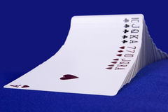 Wave of cards. There are playing cards in the photo. These are in wave formation Royalty Free Stock Image