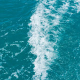 Wave caused by cruise ship Stock Image