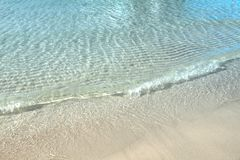 Wave of the clear blue ocean on tropical white sand beach at Koh Stock Images