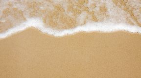 Wave on clear sand beach Royalty Free Stock Photos