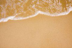 Wave on clear sand beach Royalty Free Stock Images