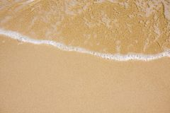 Wave on clear sand beach Royalty Free Stock Photo