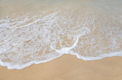 Wave on clear sand beach Royalty Free Stock Photography