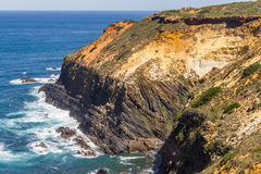 Wave and cliffs in the Beach in Almograve. Alentejo, Portugal Royalty Free Stock Photos