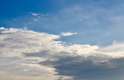 The Wave Cloud  by wind. The Cloud and Deep Blue Sky Royalty Free Stock Photo