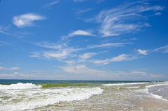 Wave and clouds wich beach and sea Royalty Free Stock Photography