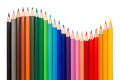Wave of colored pencils. Isolated on a white background stock photo