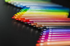 Wave of colorful magic maker on black background Royalty Free Stock Photo