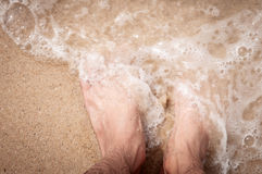 A wave comes in, as I stand and wait top down view. Royalty Free Stock Photo