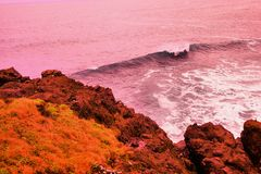 A wave coming ashore. Ocean wave cresting ashore Stock Images