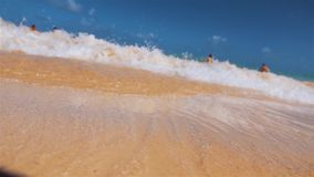 Wave cover tropical beach in Domanicain republic. A large water foam of the Atlantic Ocean wave of the Dominican Republic rolls over a beautiful orange sandy stock video footage