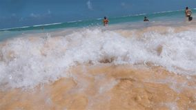 Wave cover tropical beach in Domanicain republic. Water white foam of the Atlantic Ocean wave of the Dominican Republic rolling over a stunning orange sandy stock video