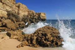 Wave crash against the rock. S. Rafael beach, Albufeira, Portugal stock photography