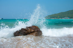 Wave crash against the rocks during a storm in the tropics Stock Image