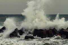 Wave crashes onto rocks Royalty Free Stock Image
