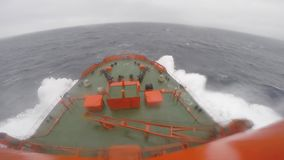 Wave crashes over bow of cruise ship