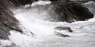 Wave crashing. Wave crash against the rocks during a storm in the Black sea Royalty Free Stock Photo