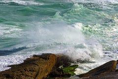 Wave crashing against rocks Royalty Free Stock Image