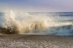 Wave crashing on the beach. Late afternoon southbourne Stock Photos