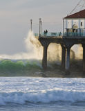 Wave Crashing into Manhattan Beach Pier Stock Photo
