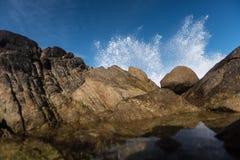 Wave Crashing On Rocks Creates Large Spray Royalty Free Stock Photography