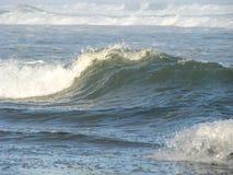 Wave crashing onto shore. A small wave crashing onto the shore Royalty Free Stock Photos