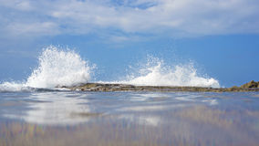 Wave crashing on reef Stock Images