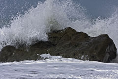Wave crashing on rock Royalty Free Stock Image