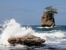 Wave crashing on rock Stock Photography