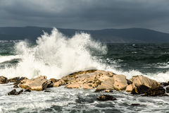 Wave crashing in the rocks Stock Images