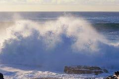 Wave crashing into rocks Stock Photography