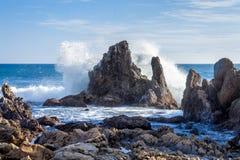 Wave crashing on rocks Stock Photos