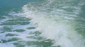 Wave create by engine propellers churn the water into waves and wakes stock video footage