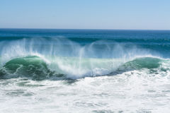 Wave Crest Breaking Along Beach Royalty Free Stock Photo