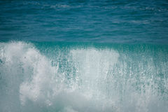 Wave cresting in the sea of cortez. Wave cresting in the turquoise waters of the Sea of Cortez in Mexico Stock Images