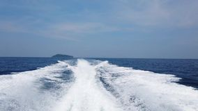 Wave from cruise boat. On water surface, sun light and horizon with blue sea. 4K clip stock video