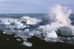 Wave crushed by the Ice block Stock Images