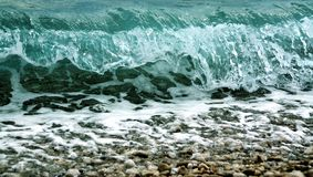Wave crushing on the pebbels beach Royalty Free Stock Photo