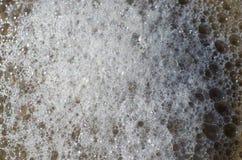 Wave del mare sulla spiaggia di sabbia Immagini Stock