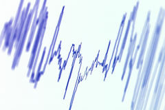 Wave diagram. Audio, seismic or stock market wave diagram. Macro closeup, shallow DOF stock photo